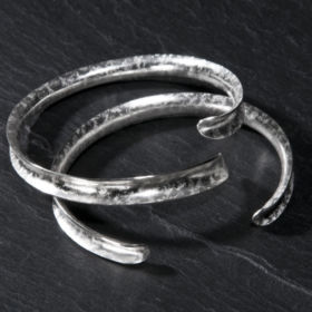 Silver 'Rockhammer' textured bangles by Annette Petch